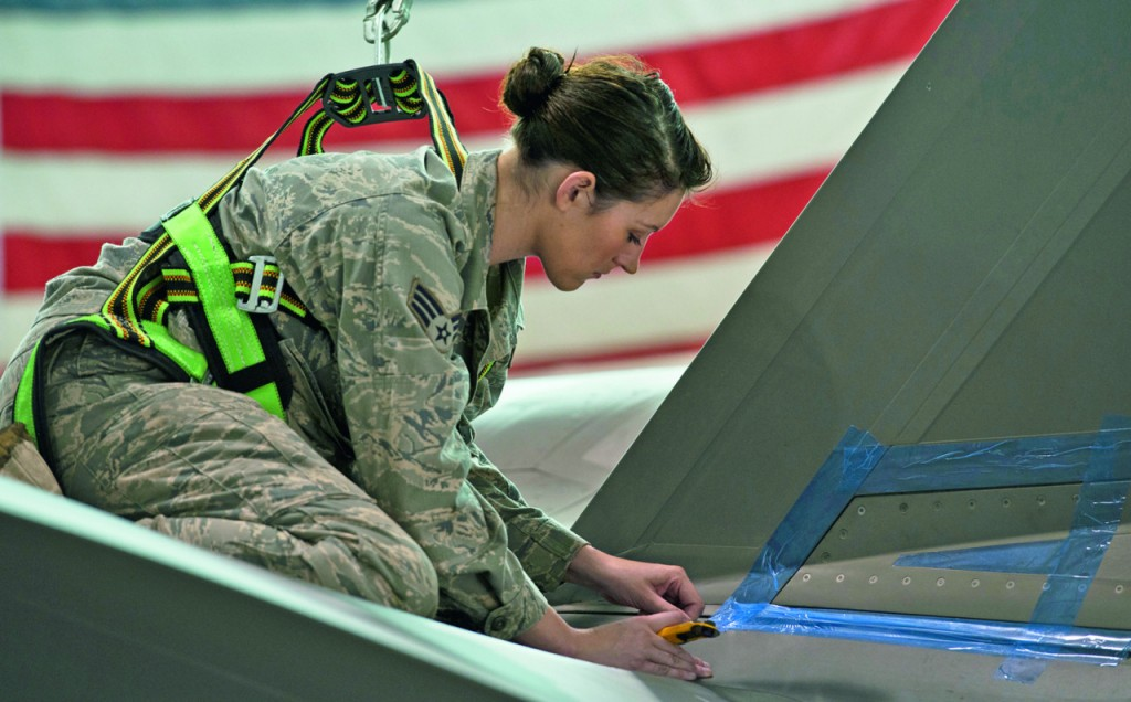 Senior Airman Jessa Fleming, a low observable technician, masks areas of an F-35 Lightning II in need of metal repair work. Fleming is responsible for maintaining the stealth characteristics of the Joint Strike Fighter. (U.S. Air Force photo/Tech. Sgt. Bennie J. Davis III)