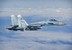 A Russian SU-27 Flanker aircraft photographed from a RAF Typhoon. RAF Typhoons were scrambled on Tuesday 17 June 2014 to intercept multiple Russian aircraft as part of NATO's ongoing mission to police Baltic airspace. The Typhoon aircraft, from 3 (Fighter) Squadron, were launched after four separate groups of aircraft were detected by NATO air defences in international airspace near to the Baltic States. Once airborne, the British jets identified the aircraft as a Russian Tupolev Tu22 'Backfire' bomber, four Sukhoi Su27 'Flanker' fighters, one Beriev A50 'Mainstay' early warning aircraft and an Antonov An26 'Curl' transport aircraft who appeared to be carrying out a variety of routine training. The Russian aircraft were monitored by the RAF Typhoons and escorted on their way. The Typhoon pilots involved in the operation were Flight Lieutenant (Flt Lt) Mark Long of 29 (Reserve) Squadron (the Typhoon operational training unit) and a French Air Force exchange pilot Commandant Marc-antoine Gerrard who is currently attached to 1(Fighter) Squadron.